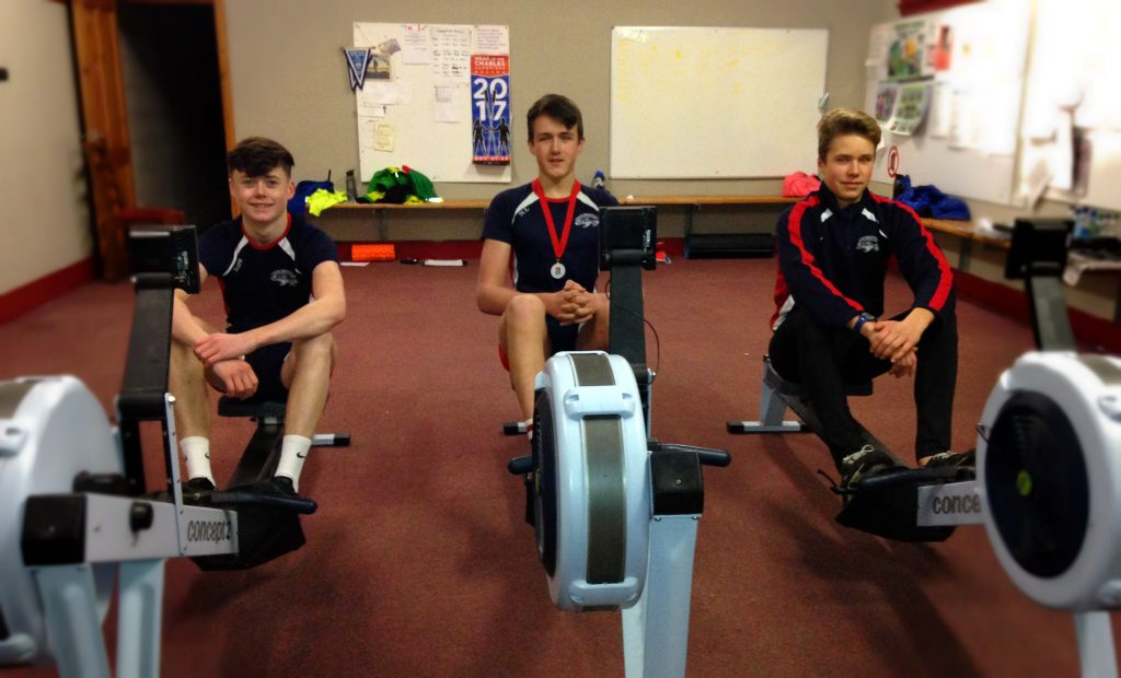 Junior rowers on ergs